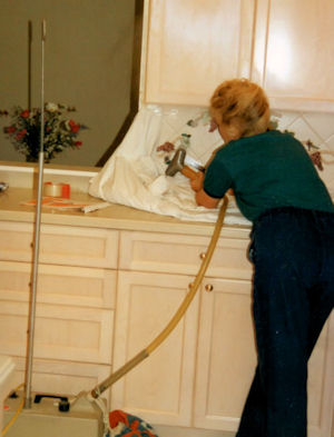 Designer removing relief tiles with a drapery steamer.