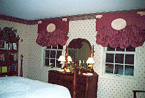 Drapes with hand-tooled leather cornices and designs.
