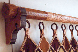 Leather covered curtain rod #1.